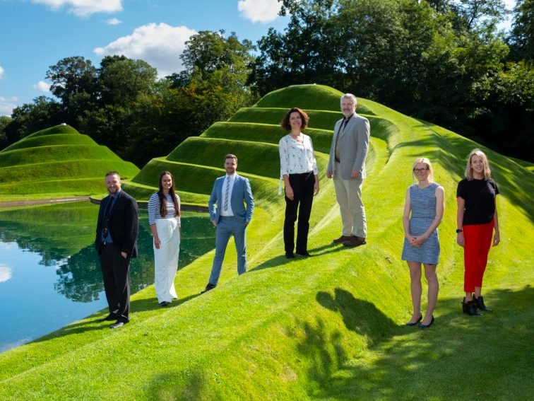 photo of Converge team on a hill